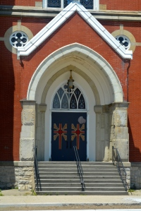The beautiful doors of St. Mary's in downtown Muskegon, Michigan, founded in 1889. ©Jean Janssen