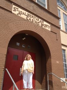 On the steps of St. Adalbert's Aid Society-the parking lot is the site of Kielbasa Idol