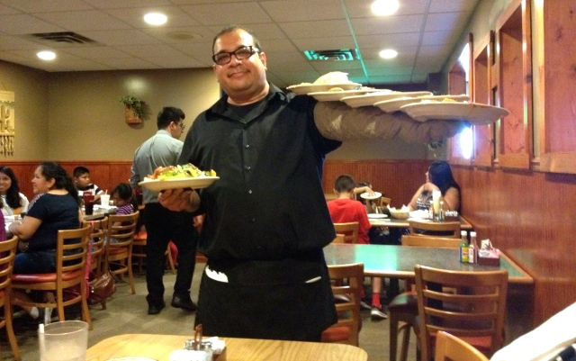 At server did an excellent job of managing all our plates at El Arriero on 28th Street in Grand Rapids, Michigan ©Jean Janssen