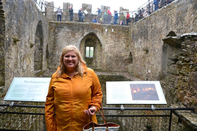 Natasha at the top of Blarney Castle just after kissing the stone. Yep, Still raining, but I am looking pretty snug after my success. ©Jean Janssen
