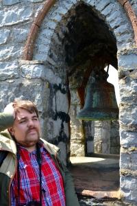 """Rocky taking a break at the top of Castle Rushen, Castletown, Isle of Man.  The bell is engraved """"Earl of Derby 1729"""" ©Jean Janssen"""