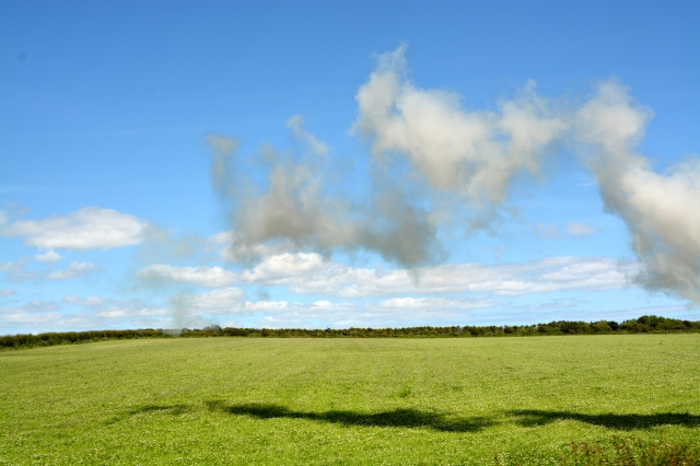 Clouds and steam from the train against a blue Isle of Man sky. ©Jean Janssen