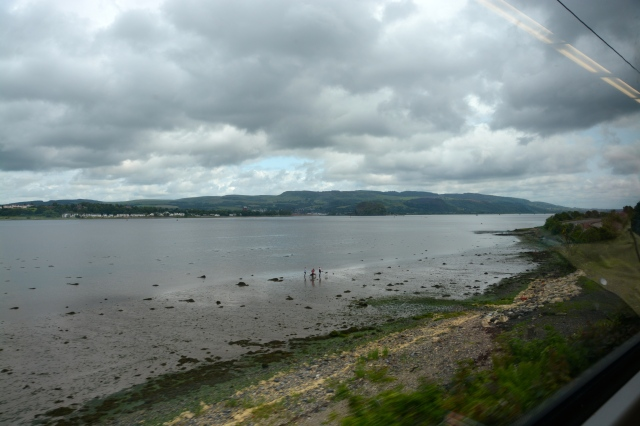 Train travel along the River Clyde from Greenock to Glasgow, Scotland. The canal is no longer deep enough for our cruise ship to go closer in to the city.  ©Jean Janssen
