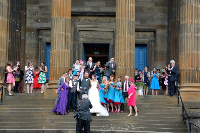 Ted and I felt like we were invited to the wedding. As seen from our double-decker Hop-on/Hop-off Bus in Glasgow, Scotland. ©Jean Janssen