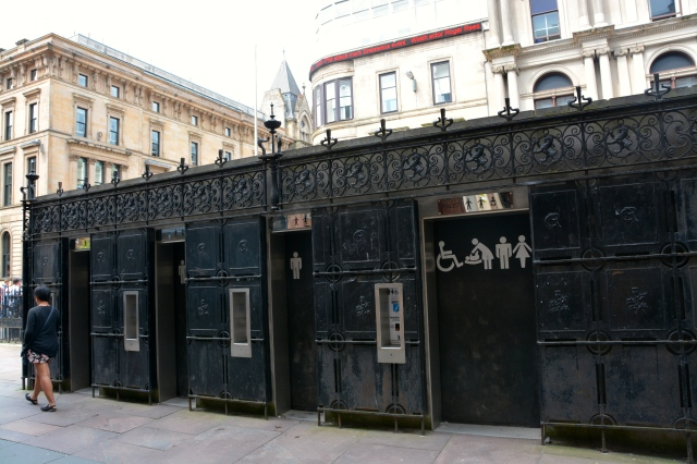 Pay toilets on the sidewalk in downtown Glasgow ©Jean Janssen