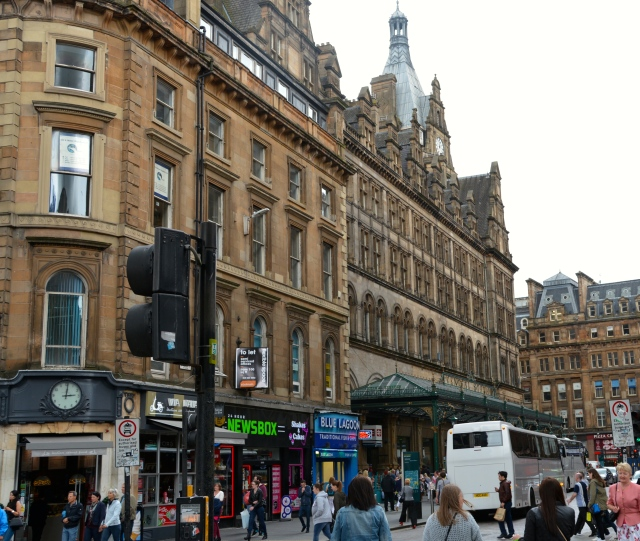 Glasgow Central Train Station.  Note the great metal awning and the fish and chips shop right next door.  ©Jean Janssen