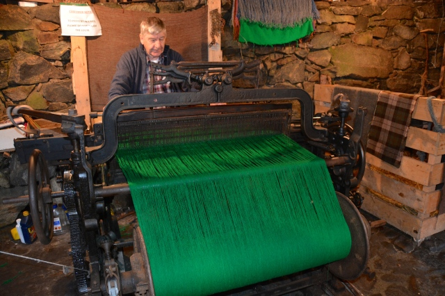 Rory weaving Harris Tweed on a traditional loom at the Blackhouse Village, Isle of Lewis, Scotland ©Jean Janssen