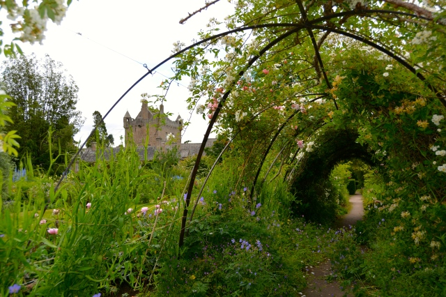 Cawdor Castle as seen through the trellis of the castle flower garden ©Jean Janssen