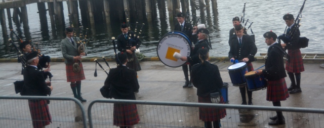 Bagpipe band outside our cabin window, Invergordon, Scotland ©Jean Janssen