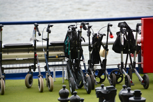 As we strolled along the waterfront at Cologne, we noted all the riverboats at dock.  Most have bicycles on their top deck that guest can check out for day use.  This boat (not ours) also had a parking area for walkers. ©Jean Janssen