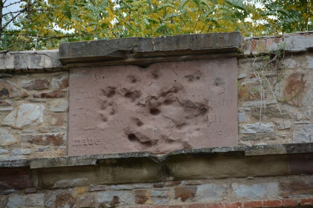 The nazi symbol was once at this spot, the guide suggested these were marks from American guns, Ehrenbreitstein Fortress, near Koblenz, Germany. ©Jean Janssen