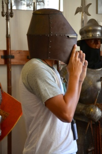 Colin tries on a helmet in the Marksburg Castle Armory. ©Jean Janssen