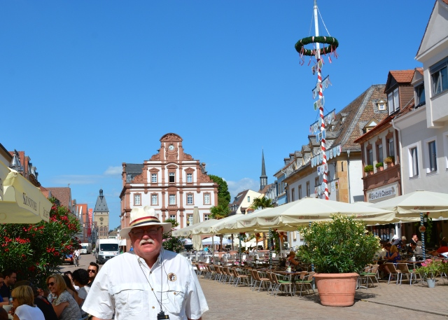 Boris on the main street in Speyer, Germany. Note the fabulous maypole. ©Jean Janssen
