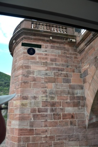 Boris checks out the markings on the bridge tower showing flooding levels and dates. Heidelberg, Germany ©Jean Janssen
