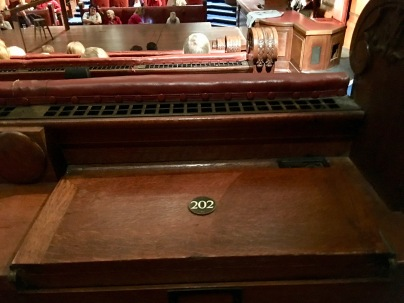 Photo ©Jean Janssen. My seat in London County Hall included a numbered place that opened to a writing desk.